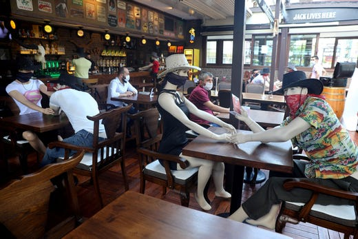 Mannequins are seen placed at tables to make customers sit according to social distancing rules at Elpaso Bar, which reopened after being closed for weeks, amid the spread of the coronavirus disease (COVID-19), in Ankara on June 24, 2020. - Turkey, a nation of some 83 million, has removed most restrictions, reopened restaurants and resumed mass prayers but officials have warned against complacency. Turkey's daily infections have risen in recent weeks to over a thousand, and authorities have made face masks mandatory in public in several cities including Istanbul. (Photo by Adem ALTAN / AFP) (Photo by ADEM ALTAN/AFP via Getty Images) ORIG FILE ID: AFP_1U12S2