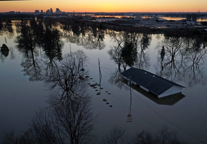 A drone photograph shows a structure submerged by flood waters in Lousiville, Kentucky, on Feb 26, 2018, after substantial rains caused severe flooding in the area.