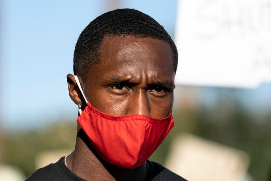 Marcher wears a mask on Juneteenth
