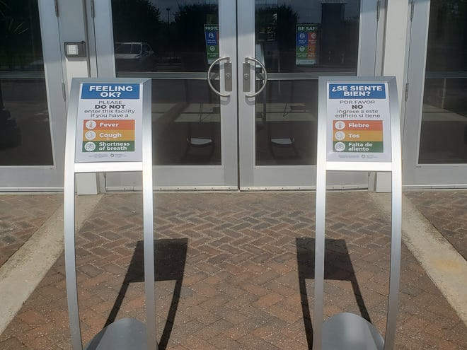 Signage outside the Ardmore Convention Center asks guests not to enter if they are not feeling well or have symptoms of COVID-19. The convention center has recently reopened to guests with new cleaning measures and procedures to help prevent the spread of the virus.