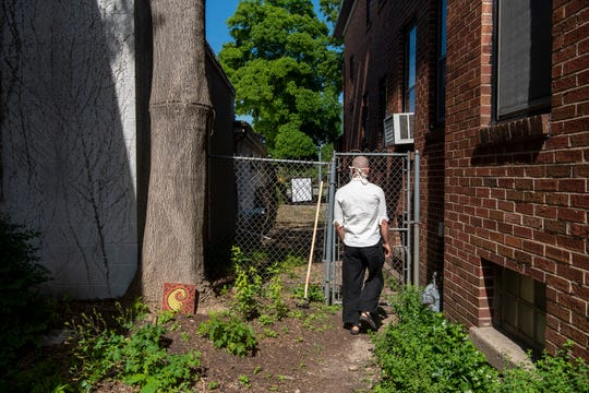 Chiezan Tomczyk strolls around the Buddhist monastery where he lives on Thursday, June 25, 2020 in Battle Creek, Mich. Next door, Karma House has converted the former Meyer's Toy World into a yoga and wellness studio.