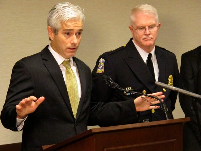 In this Oct. 28, 2014, file photo, assistant U.S. attorney Dave DeVillers, left, discusses updated charges against members of an alleged gang as Columbus Deputy Police Chief Ron Gray listens during a news conference in Columbus, Ohio. A federal indictment accuses Larry Dean Porter of exchanging drugs for sexual access to children of drug-addicted parents. The indictment says Porter repeatedly traded drugs for sex with three girls, with several other adults helping transport the victims to Porter's house. Porter both raped the girls and filmed himself raping them, U.S. Attorney Dave DeVillers said Wednesday, June 24, 2020.