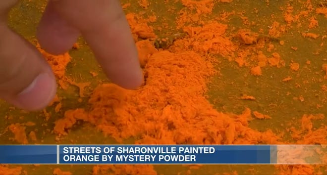 Streets of Sharonville have been painted orange by mystery powder.