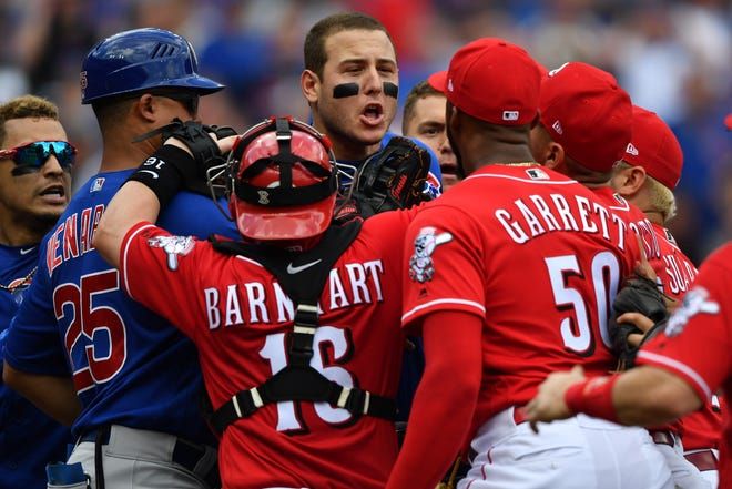 Anthony Rizzo #44 of the Chicago Cubs confronts pitcher Amir Garrett #50 of the Cincinnati Reds at the end of the seventh inning at Great American Ball Park on May 19, 2018 in Cincinnati, Ohio. Benches cleared after Javier Baez #9 of the Chicago Cubs struck out to end the inning and got into a shouting match with Garrett.