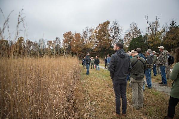 Dr. Dwayne Estes leads a tour through grasslands in the fall.