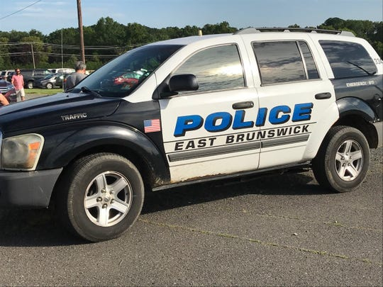 Two East Brunswick police officers are being hailed for rescuing a man attempting to jump onto the New Jersey Turnpike from a Route 18 overpass.