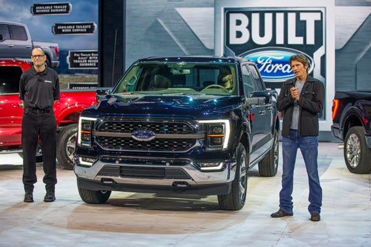 (Left) Todd Eckert, Ford Motor Co. truck group marketing manager, and Denis Leary, actor, philanthropist and F-150 reveal host, beside the all-new F-150 King Ranch in Antimatter Blue at the official reveal on June 25, 2020.