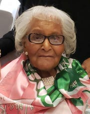 Ola Mae Walker Spinks enjoys a luncheon of her sorority, Alpha Kappa Alpha, about a year ago when she was age 105 (family photo).