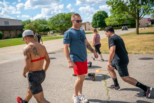 Travis Heidt, head coach and owner of High Caliber Strength and Fitness, in Troy, leads an outdoors cross-fit class, June 25, 2020.