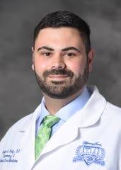 Dr. Bryan Kelly