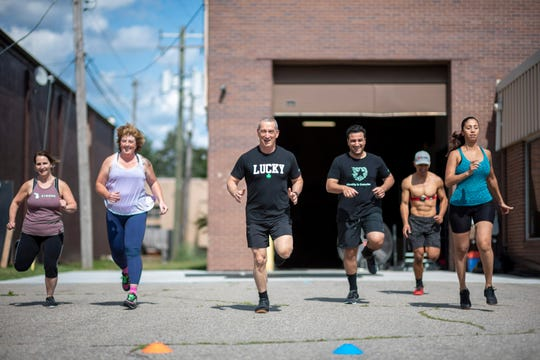 People participate in an outdoors cross-fit class at High Caliber Strength and Fitness, in Troy, June 25, 2020.