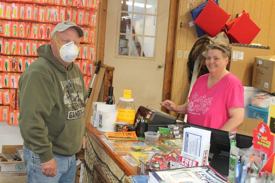 Jill Johnson helps a customer at JJ's Tackle Shack in Ontonagon, Michigan, on Thursday.