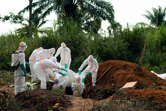 In this Sunday, July 14, 2019 file photo, an Ebola victim is put to rest at the Muslim cemetery in Beni, Congo.