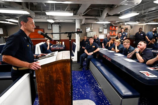 In this image provided by the U.S. Navy, Capt. Edward Crossman, assigned to the guided-missile cruiser USS San Jacinto (CG 56), speaks to the sailors aboard the ship during a talent show in the Arabian Sea May 15, 2020.