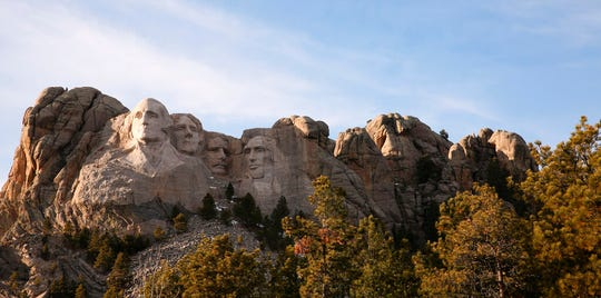 This Dec. 8, 2019, photo shows shows Mount Rushmore in Keystone, S.D. Organizers have scrapped plans to mandate social distancing during President Donald Trump's appearance at a July 3, 2020, Mount Rushmore fireworks display and won't limit the crowd due to coronavirus concerns, South Dakota Gov. Kristi Noem said Thursday, June 4, 2020.