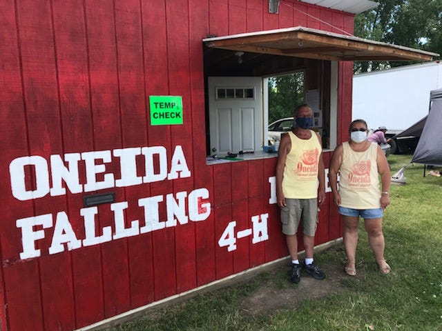 Bill Ver Voort and Grace Koehler help run the Oneida Farmers' Market.