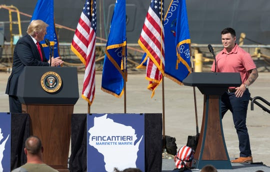 President Trump listens as shipyard worker Tyler Cahill speaks Thursday, June 25, 2020, at Fincantieri Marinette Marine in Marinette, Wis. Trump's visit comes in the middle of his reelection bid against former Vice President Joe Biden, who secured the Democratic nomination earlier this month after a crowded primary contest. Both candidates hope to claim Wisconsin this November after Trump narrowly won the state in 2016, handing it to Republicans for the first time in years.
