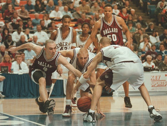 Henderson County's Scotty Bannwart (40) fights for the loose ball against Ballard's Will Partin (4) during the 1999 Sweet 16 at Rupp Arena.