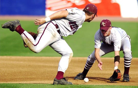 Dustin McGill, right, scoops up the ball as Neil Sellers passes by as they play Ballard in the 2000 state championship game in Lexington.