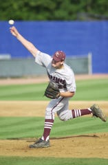Henderson County's Seth Stanley pitches during the 2000 state championship game in Lexington.