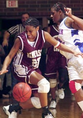 Henderson County's Ashley Hawkins loses the ball out of bounds after being fouled by Christian County's DeErica Jones late in the fourth quarter of a triple overtime thriller in the 2003 Second Region semifinal game at Colonel Gym.