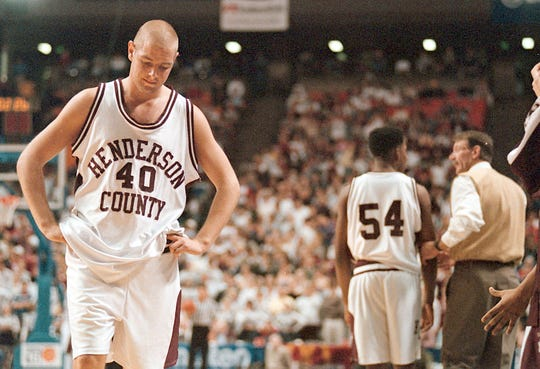 Henderson County's Scotty Bannwart (40) waits on the court until Edaghogho Eferakeya (54) takes his place after Bannwart fouled out of the game against Ballard High School during the 1999 Sweet 16 semifinal at Rupp Arena.