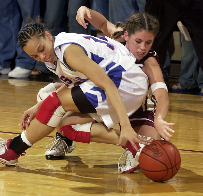 Henderson County's Krista Hatfield scrambles with Christian County's Shaleea Petty in the 2003 Second Region semifinal game at Colonel Gym.