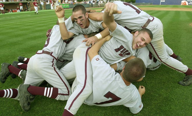 Henderson County's Andy Capps, left, and Forrest Williamson celebrate with the team after the Colonels won the 2000 state baseball championship at Cliff Hagan Stadium in Lexington.