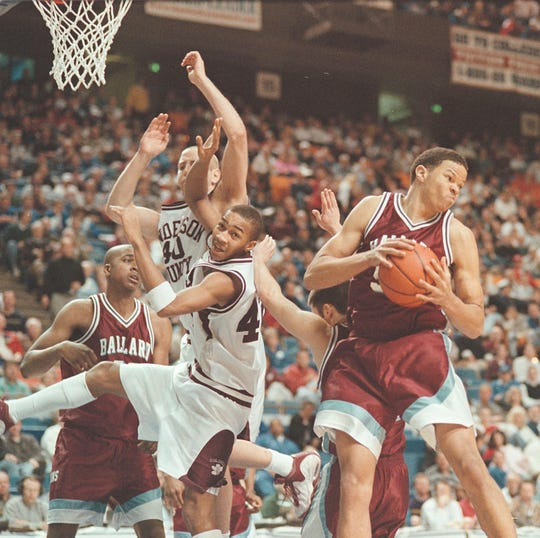 Henderson County's Ervin Miiler (42) and Scotty Bannwart can't hold onto the rebound as Ballard's Mac Wilkinson (50) heads down court during their 1999 Sweet 16 semifinal game at Rupp Arena.