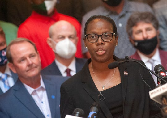 Nikki McCray-Penson, the Mississippi State women's basketball coach, addresses media with athletic directors and coaches advocating for a new state flag during a news conference at the State Capitol in Jackson, Miss., Thursday, June 25, 2020.