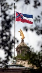 As debate continues over the state flag within the Mississippi State Capitol in Jackson, Miss., the flag flies over the Capitol Thursday, June 25, 2020.