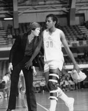 Shelia Collins of Tennessee walks past Lady Vols coach Pat Summitt during a game.