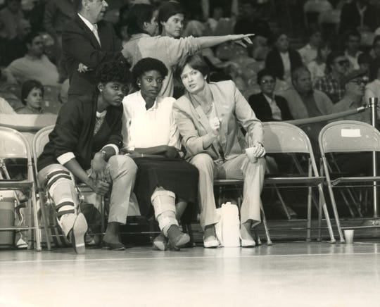 Tennessee players Lisa Kimbrough, left, and Val Freeman, center, listen to Lady Vols coach Pat Summitt during a game in the 1980s.