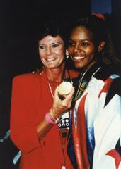 Tennessee Lady Vols coach Pat Summitt with Nikki McCray who won a gold medal with USA women's basketball team in 1996 and again in 2000.