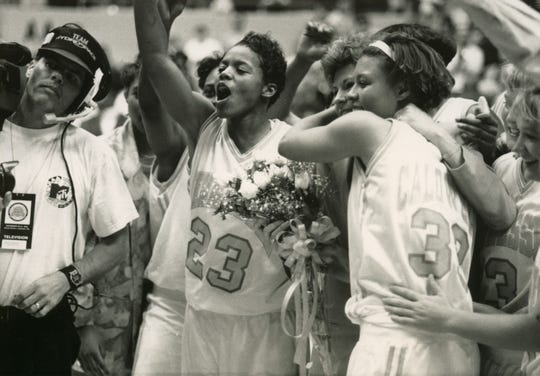 Tennessee players Lisa Kimbrough, left, and Nikki Caldwell celebrate Lady Vols coach Pat Summitt on her 500th career victory on Nov. 21, 1993 in the season opener.