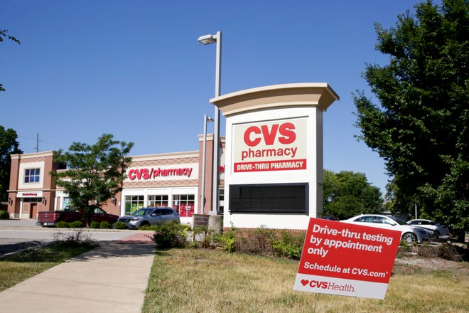 A sign advertising a drive-thru testing site sits outside a CVS Pharmacy located at 1725 Salem St., Thursday, June 25, 2020, in Lafayette.