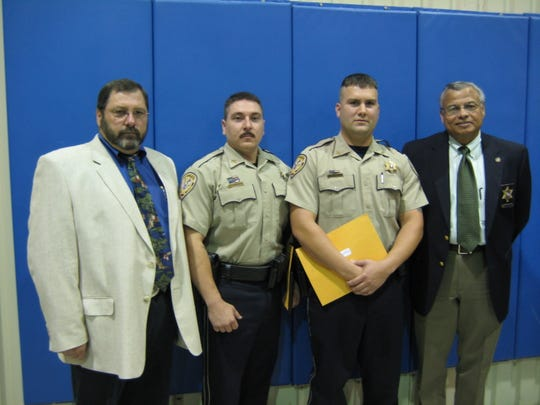 This 2008 photo from the St. Landry Parish Sheriff's Office shows Deputy Leon Boudreaux, second from the left, after his graduation from the St. Martin Sheriff's Basic Training Academy. Boudreaux was named the top physically fit cadet of the academy and also broke the academy's push-up record. Pictured from left are Patrol Supervisor Lt. Col. Paul DiCapo, Boudreaux, Deputy Mark Fontenot and Chief Deputy Hilman Popillion.