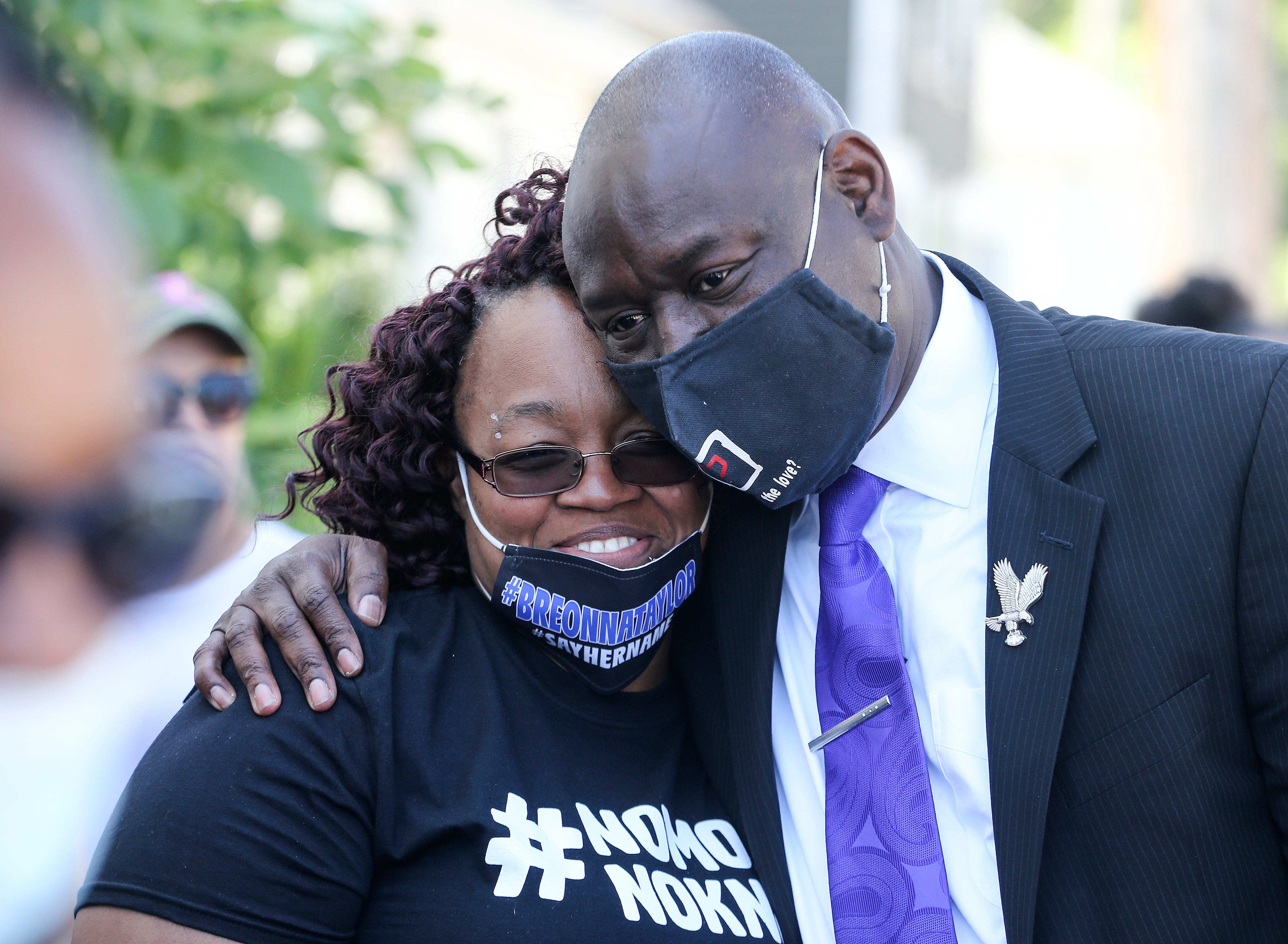 Tamika Palmer, mother of Breonna Taylor, who was killed by police, gets a hug from attorney Ben Crump before the start of a rally on the steps of the Kentucky State Capitol on Thursday, June 25, 2020.