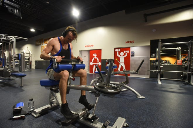 """""""I'm happy to be back and working out,"""" Austin Syrek of Williamston said  Thursday, June 25, 2020, while working out at Crunch Fitness in Meridian Township.  The gym opened for business Thursday despite a last-minute federal court rulingthat delayed the reopening of gyms in the Michigan."""