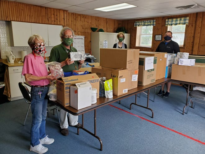 OhioHealth donated gloves, toilet paper and other surplus COVID-19 supplies to Shelby Help Line Ministries. Pictured are Rev. Patti Welch and Garland Gates of FISH Pantry, Sheryl Cramer of Shelby Help Line Ministries, and Cody Albert of OhioHealth.