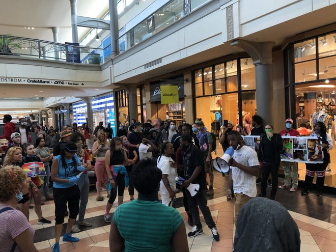 Protesters gathered on the first floor of Mayfair mall, after they walked and chanted throughout the mall for more than an hour during a protest last month. Protests have filled the mall in recent weeks as groups seek justice for Alvin Cole, a 17-year-old killed by a police officer outside the mall in February.