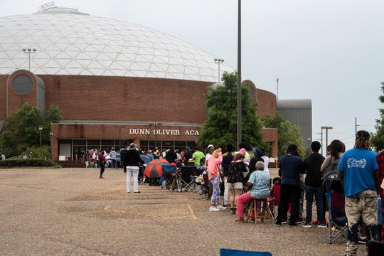 People wait in line to troubleshoot unemployment claims outside the Dunn-Oliver Acadome in Montgomery, Ala., on Thursday, June 25, 2020.