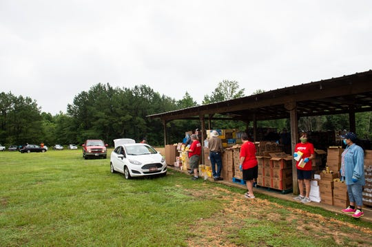 Montgomery Area Food Bank volunteers pass out food at Old Kingston Baptist Church in Prattville, Ala., on Thursday, June 25, 2020.