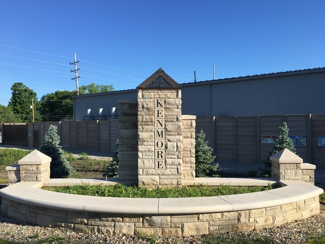 Weeds grow in a limestone planter that was built to help improve the appearance of an I&M electrical substation.