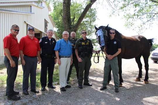 Mounted Patrol horse Randy shows off his new protective face shield.