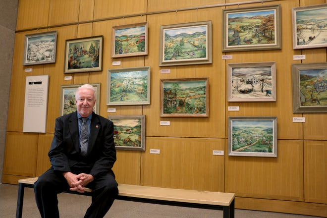 Tennessee State Museum Senior Curator of Art and Architecture Jim Hoobler in front of the Sally Vaughan salon wall.
