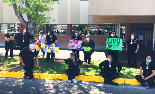 San Juan Regional Medical Center staff welcome an EMS escort of Lilly Tsosie on June 19 when her body was transported from Albuquerque.