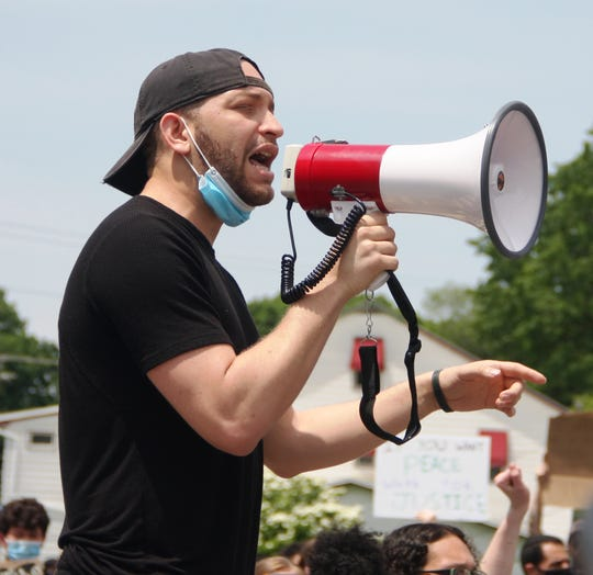"""Amaury Abreu speaks during a peaceful protest against police brutality in downtown Lebanon. Abreu, 24, is """"passionate about social issues. No matter what I do, I'm going to be passionate about it. I want to be involved with my community. I enjoy challenging the status quo."""""""