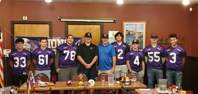 Lions All-Star North team coaches Darren Trueblood (center-right) and Zack Trueblood (center-left) stand with players from left to right Alex Beltran, Jacob Johnston, Jacob Anderson, Trayton Laustalot, Riley Seay, Cody Sisco and Tyler Carey at the Lions All-Star game luncheon at Lulu's Eating & Drinking Establishment on Thursday, June 25, 2020.