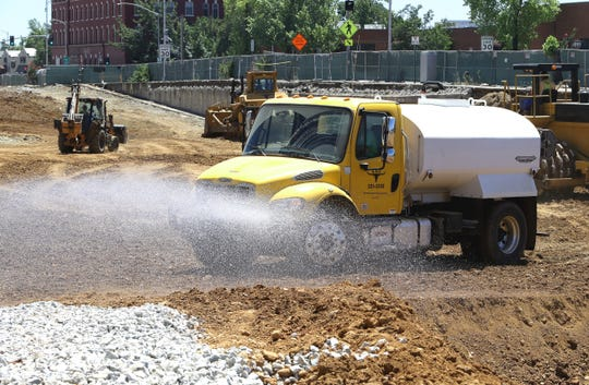 A water truck spray water to keep dust down at the site of the former California Street parking garage. The parking structure was demolished to make way for a multi-story residential and commercial building downtown.